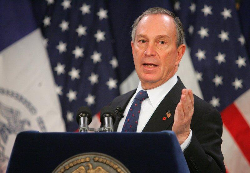 Michael Bloomberg  addresses members of the press and  public as they convene for a press conference
