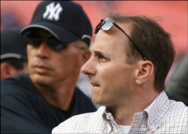 New  York Yankees'  GM Brian Cashman  , foreground  along with the team's manager Joe  Girardi  .................