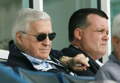 George Steinbrenner foreground  and his son Hank aseat  in their executive suite  look on as the  the  team  plays ..........