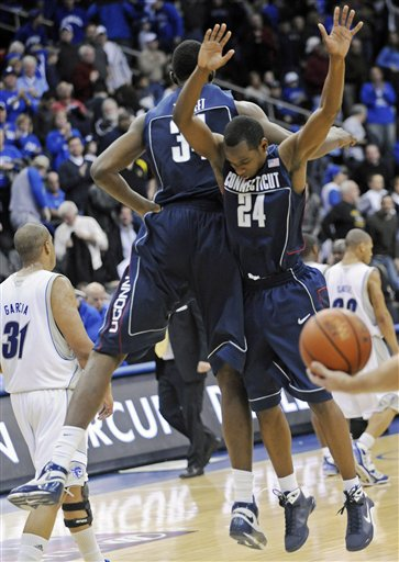 Craig  Austrie (24)  and  Thabeet  celebrate   after their  62-54  victory  over  Seton Hall in Newark , NJ.  picture  appears courtesy of  ap/photo/Bill Kostroun......