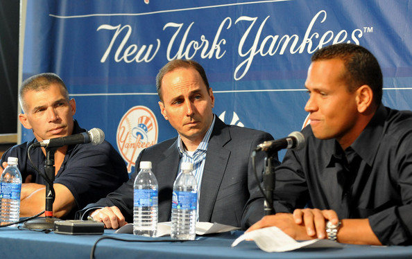 Alex  Rodriguez (right)  along  with  Yankees' GM Brian  Cashman (center)  and  the  team's  manager Joe Girardi.