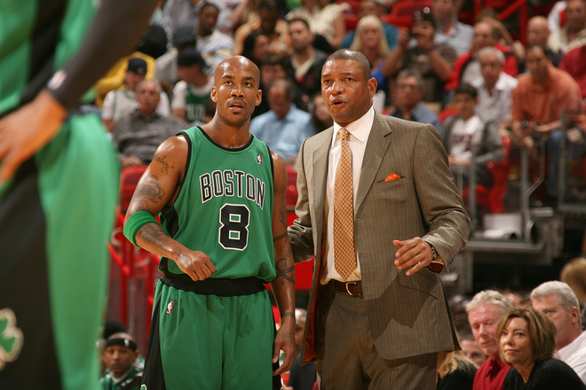 Celtics' coach  Glenn 'Doc'  Rivers  speaks  with  his   point  guard  Stephon  Marbury    during the  game.