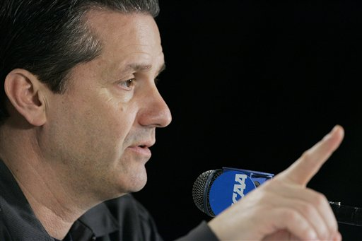 John  Calipari  coach  of  the Memphis  men's  basketball  team  addresses members of  the  convened  press  in  Kansas City  , Missouri   prior  to  his  team  taking   on  Cal St  Northridge  in the  first round of  the  NCAA Tournament.