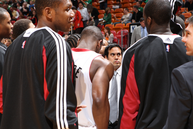 Erik Spoelstra coach of  the Miami  Heat   speaks  to  his players  before  the  game  against the  Boston Celtics played  at the American Airlines  Arena, Miami, Florida,.