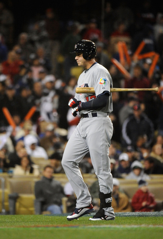 Evan  Longoria   strikes  out  in  the  ninth   inning  of  the  game  against  Japan  in the  semi  finals  of  the  World Baseball   Classic.