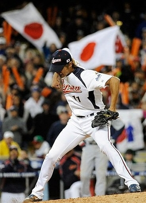 Japanese   pitcher  Yu  Darvish   celebrates  after  striking   out  Adam  Dunn  of  team  USA  in  the semi   finals   game  of  the  Worl  Baseball  Classic.