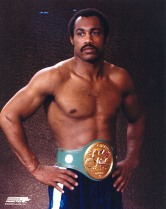 Ken Norton  adorned  with  the  Heavyweight title   belt.  The  one  elusive  professional  accolade that  he  would  not  ever  win  in the   ring.
