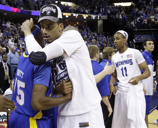 Memphis  forward   Shawn Taggart embraces  Tulsa's  Justin Hurtt (15)  after the  Tigers' emphatic   win  of  the  Conference  USA  basketball  tournament title.