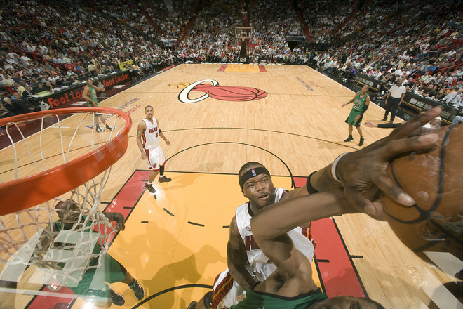 Jermaine O'Neal of  the  Miami  Heat  blocks  the  shot  of  a  Celtics'  player  during  the  game.