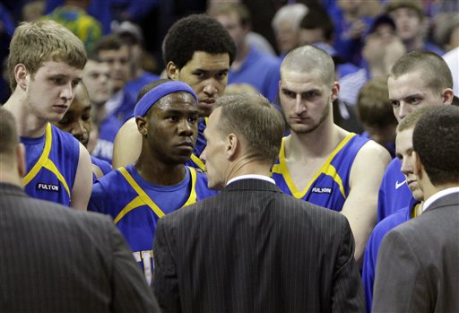 Tulsa  coach  Doug  Wojcik  speaks  to  his players  after  the  loss  to Memphis   in  the  Conference  USA tournament   championship  title game .