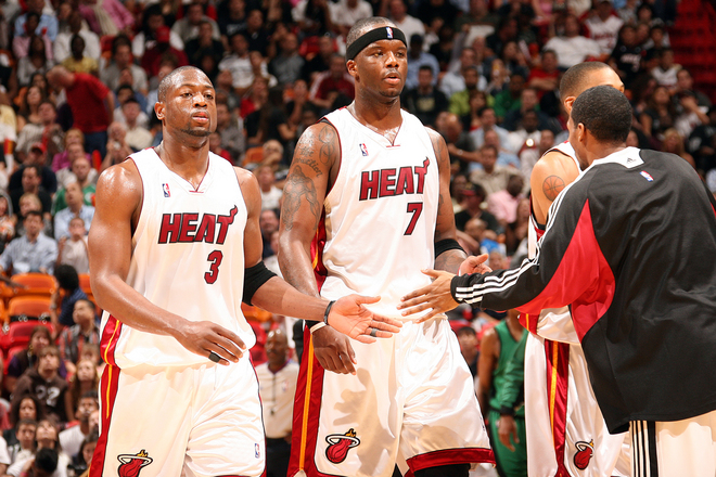 Wade and teammate  Jermaine  O'Neal are  substituted during  the  game  against the  Boston Celtics.  The  Heat  would  go  on to   defeat the  Celtics 107-99 in a  thoroughly entertaining  game. picture  appears  courtesy of  nbae/getty images/ Victor Baldizon ...............