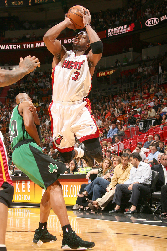 Wade   takes   the  leaping  jump  shot  for which  the  Celtics'  Ray Allen  has no  answer  ....