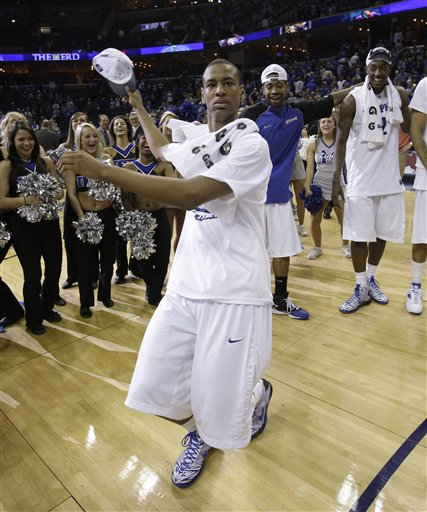 Wesley  Witherspoon  of  Memphis  dances  oncourt  after  the  Tigers'  triumph  over   Tulsa   in  the  Conference  USA  championship  title  game  played  in Memphis  ,  Tennessee.  picture  appears  courtesy of  ap/photo /   Mark  Humphrey  .................
