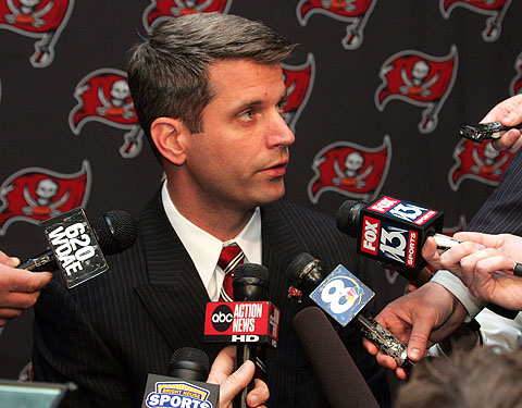Bucs' GM Mark Dominink  seen  here with  members  of  the  local  press in the Tampa  Bay  area .