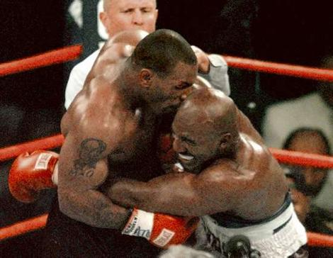 Evander Holyfield   becomes  the  appetizer   for Mike   Tyson  during  their  much  heralded  bout.