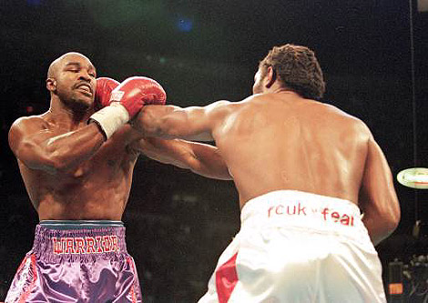 Holyfield and  Lewis  (right) do  battle  once  again in their  rematch  the  same year.