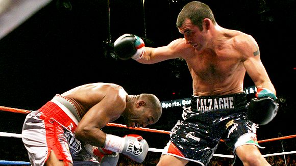 Bernard  Hopkins looks to evade a  punch  from  Joe Calzaghe  in their   light   heavyweight   bout.