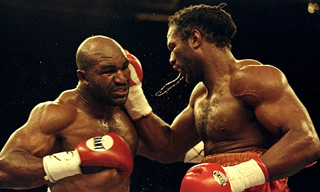 Lennox  Lewis (left)  seen here  battling  Evander Holyfield  in their  heavyweight title   bout  held  at Madison  Square  Garden  in  1999.   picture appears courtesy of ap/photo/ Todd  Donald ........