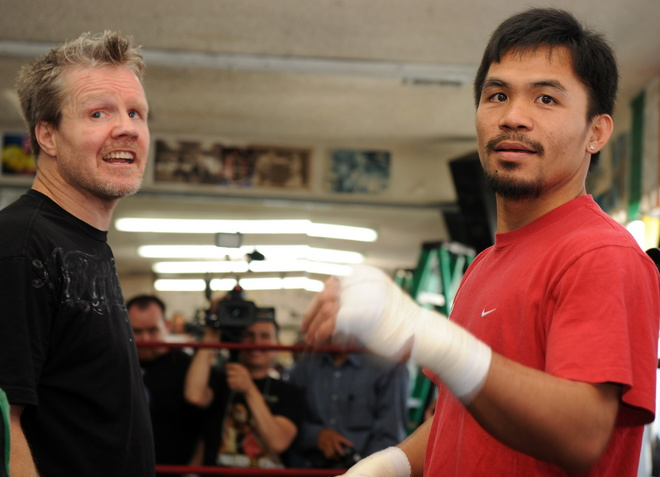 Manny  Pacquiao  and   his  trainer  Freddy  Roach  make  some   adjustments  to the  fighter's  training   regimen.    picture  appears  courtesy  of  getty images/  Rick  Baldizon...