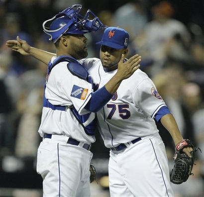Mets' catcher  Ramon  Castro  congratulates  teammate  Francisco  Rodriguez  after the  team's  4-3 triumph over  the Washington  Nationals  at  Citi Field  in  New York City, NY. picture  appears   courtesy  of  ap/photo/  Julie  Jacobs ...............