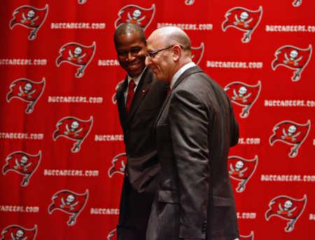 Raheem Morris   of the  Tampa Bay Buccaneers seen  here  with  Bucs' executive  Joel Glazer.