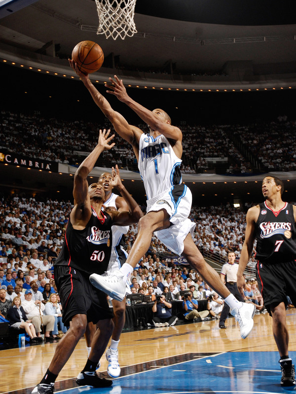 Rafer Alston  point   guard for  the  Magic  goes  up  for  the  layup  against  the 76ers.
