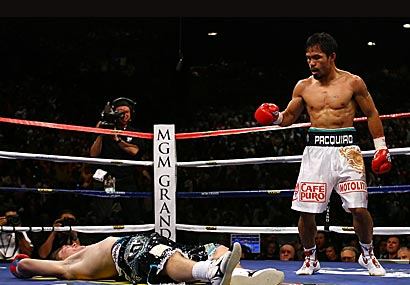 A prostrate Hatton lies on the canvas  motionless after  the third and  descisive knockdown of  the  bout. The  referee  would  stop the  fight with Hatton  being  unable  to come out for the third round  of the light welterweight title bout.  picture  appears courtesy  of getty  images/Ethan Miller ..............
