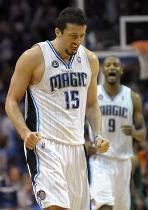 Hedo  Turkoglu  reacts after scoring  a  three  pointer  during  the  game   whilst  his  teammate  Rashard  Lewis looks  on .