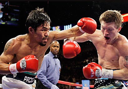 Pacquiao lands a crushing blow to the  head  of  Hatton.