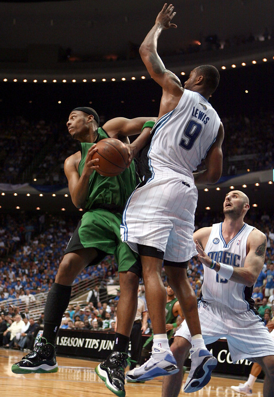 Paul  Pierce  of  the  Celtics  is fouled  by  the  Magics'  Rashard  Lewis   during the  game  .