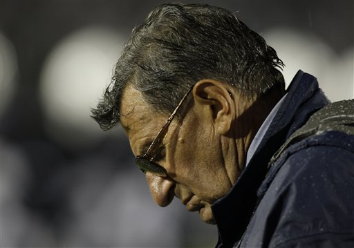 A  gloomy  looking  Joe Paterno  stands  on  the sidelines  after  the  game inexplicably   at  a  loss   for words   after  his   team's   defeat  by  Iowa 21-10.   picture  appears  courtesy  of  ap/photo/ Carolyn  Kaster  ................