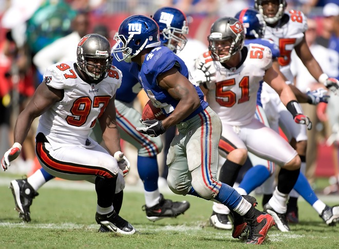 Giants' running  back    Ahmad  Bradshaw  (44)  runs  the  ball  against the  Buccaneers  on   Sunday.   The Giants'  offense   had  their  way  with  an   undersized  and   unathletic  Bucs'   defensive  squad   throughout the entire  game.      picture  appears   courtesy of    getty  images/  J  Meric  ...................................