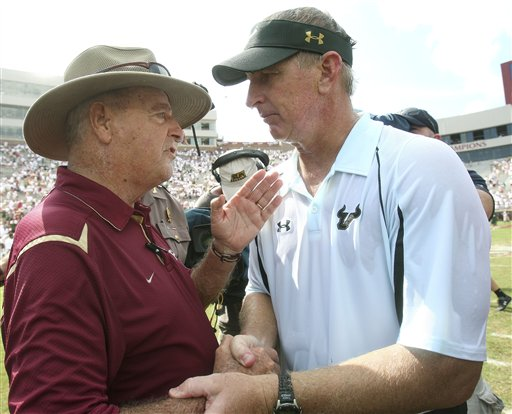 Bobby  Bowden ,left,  greets  his  counterpart   Jim  Leavitt   after  the  collegiate  football  game   played   between  their  respective  teams.      picture  appears courtesy  of  ap/photo /  Phil  Coale  ..................