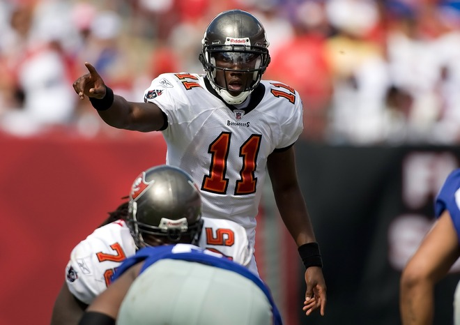Bucs'  backup  quarterback   Josh  Johnson (11)  signals a  play   prior  to the   snap.     Johnson   has  since  been  promoted  to  the  starting   position  with  Leftwich  being   demoted  to  the   role  of   backup.   No   word as   of  yet  as  to  when    rookie  Josh  Freeman  will  take  to  the field.   He's still  Raheem  Morris'   'project  in the  making'   as  of  now.      picture  appears courtesy  of  getty  images  /  J  Meric  ..............................