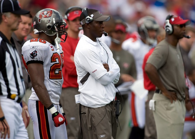 Bucs'  coach   Raheem Morris  (arms folded)  watches   his  team  from  the  sidelines  as  they  play  the  New  York   Giants  on  Sunday  in  an  NFL  game  played  at   Raymond  James  Stadium  in  Tampa ,  Florida.  picture  appears  courtesy  of  getty  images/   J   Meric  .................