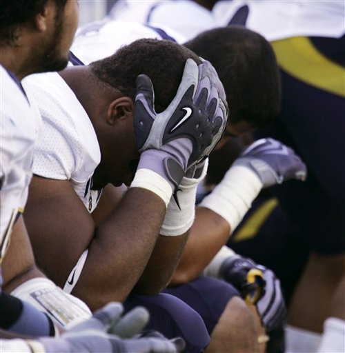 Cal's  Jerome   Meadows  ,left,  sits  with his head  buried in  his   hands  unable to  watch  the  unfolding  debacle.  Seated   alongside him is  teammate  J P  Hurrell  as the  final  moments  of  the  game wind  down .  picture appears  courtesy of   ap/photo/ Don Ryan   ...............