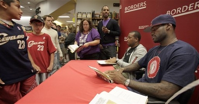 Cavaliers'  player  LeBron  James   signs  copies   of  book  'Shooting  Stars'  at  a  book  signing   at  a Borders  bookstore in  Westlake  ,  Ohio.   The   player    seeks   impending  free  agency   after  the  2009-10  NBA   season.   And  it's  believed   that  there'll  be  a  fullcourt  press  by   both  the New  York  Knicks  and  New  Jersey  Nets  to  acquire  the  player.   The  book   is  James'   first  take  at   writing   and  he was  assisted  in the process  by  noted   author  Buzz  Bissinger , who   wrote   'Friday  Night  Lights'  .   picture appears  courtesy  of   ap/photo/  Amy  Sancetta  .......................