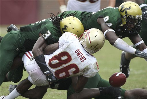 Florida  State wide  receiver  Rod  Owens (86)  fumbles  the ball  after  he's  hit  by  Bulls  defensive  player    Jerome  Murphy   ..................