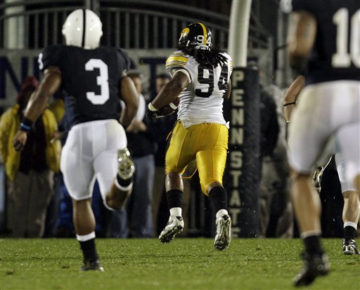 Iowa's  Adrian Clayborn (94)  returns  a  blocked  punt  for the   score  in  the  21-10  upset  victory  over  the  Nittany Lions   by  the    Hawkeyes .   picture  appears   courtesy  of   ap/photo/  Carolyn  Kaster  ....................