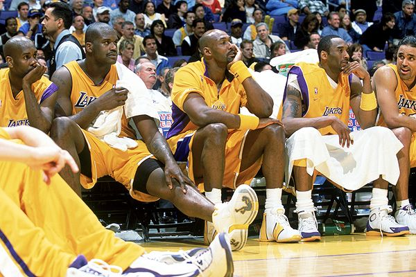 From  left  to  right  Gary Payton,  Shaquille O'Neal,  Karl  Malone  ,  Kobe  Bryant   and   Rick  Fox.   All  have   a  forelorn   upon them as  they began  to    realize  that   the  improbable  and  the   inevitable was  about to  happen.   They  would   lose  the  NBA  Final   series  to  the  Eastern  Conference's  Detroit  Pistons.       picture  appears  courtesy  of   getty  images /    Mitchell   Russell  ........................