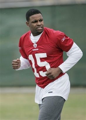 This   picture  from  May  of this   year  shows  rookie   draftee   Michael  Crabtree  at  the   49ers'  training   facility  in  Santa  Clara,  Ca,.  The 49ers have filed tampering charges with the NFL against the New York Jets regarding Crabtree, Jets coach Rex Ryan confirmed .   picture appears courtesy of  ap/ Paul   Sakuma   .................