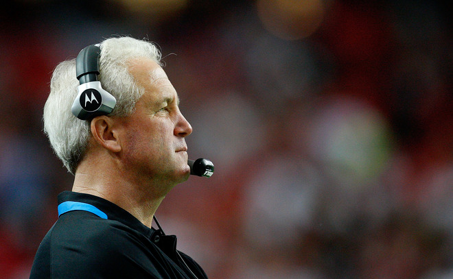 Panthers'  coach  John  Fox   looks  on  in the  Georgia  Dome  in  Atlanta  in  a  game  played between  the  Falcons  and  Panthers.   Fox's  Panthers  would   go  on to  lose the  game 28-20  to  their  conference   rivals .   picture  appears courtesy  of   getty images/  Kevin  C. Cox   .......................