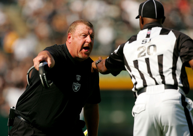 Raiders'  coach   Tom  Cable   argues  with the  sideline   judge   Barry  Anderson   during  the  game  played  against  the  Denver  Broncos   on  Sunday  afternoon.   picture  appears   courtesy  of  getty  images/  Ezra  Shaw  ...................