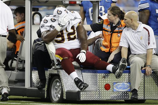 Redskins'  defensive  tackle  Albert  Haynesworth   covers   his  face  while   being   taken  off  the   field   on  a  motorized  cart .  The  player  suffered  an  injury   during  the   game  and  as a  matter  of   precaution  his   day  was   curtailed  in  order   for   him  to   undergo  X-rays  to  make   sure  his  injury  wasn't   far  more   serious.  With   $100 million  being  vested  in the  player  ,  the   team  has  yet  to   reap   any  reward   from him   by  way  of  leadership   or  his   presence   on the  field.   picture  appears  courtesy  of   ap/photo/ Paul  Sancya    ..........................