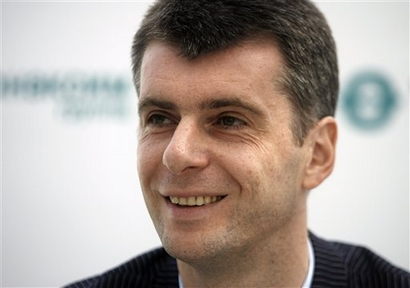 Russian  tycoon  Mikhail  Prokhorov  listed  as  Russia's  wealthiest  person  and  at   #40   Forbes'   list   of the  world's wealthiest  individuals   for   2009.   Prokhorov   has  made  a  detailed    offer  to   purchase a  majority  stake  in the  New  Jersey   Nets   along  with  a  capital  infusion   provided   for  the  development  of  the  Atlantic  Yards  project.  An  area that will   encapsulate   residential    as  well  commericial   properties   with  its  centerpiece  being   the  Barclay  Center-  which  will  become  the  new  home of the  New Jersey  Nets.     The  development   will  be  situated   in Brooklyn,  NY,.      picture appears   courtesy  of   ap/photo/  Mikhail Metzel   ......................................