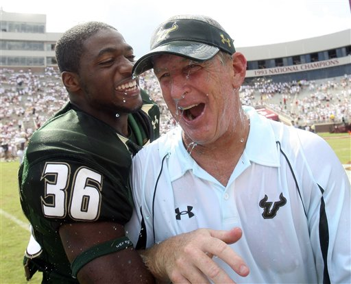 University of South Florida  coach  ,  Jim   Leavitt  celebrates  with  one of  his   players   Sam  Barrington after  their   surprise  victory  over    Florida State  , played at  the  Seminoles   home  venue   of  Doak  Campbell  Stadium in Tallahasse ,  Florida.   The unranked  USF Bulls  would  go  on  to  defeat  the Seminoles  17-7  in  a  well  earned   victory.    picture  appears courtesy of   ap/photo/ Phil Coale  ....................