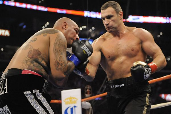 Vitali Klitschko , right,  starts  to  dictate  and  take the   fight  to  his  challenger   Chris  Arreola  .   picture appears  courtesy of  ap/photo/  Mark J Terrill   ............................