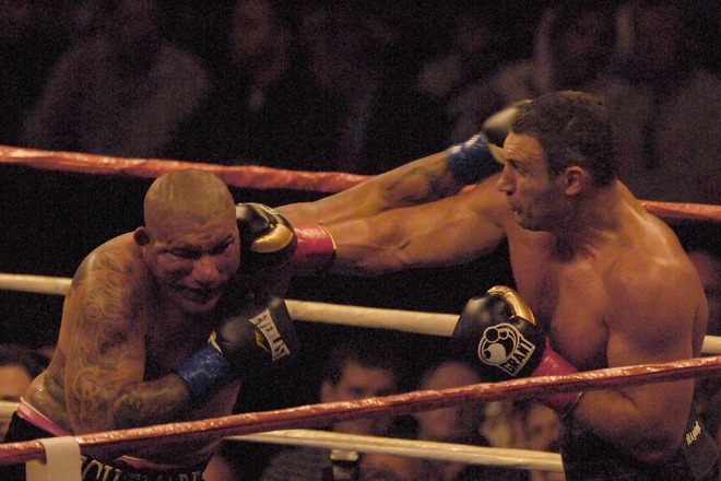 Vitali  Klitschko  throws a  right  hand  that  catches his  opponent  Chris Arreola  squarely  on  the   side  of  his   head    in the fifth   round of  their  heavyweight title   bout  at  the   Staples   Center  in Los  Angeles  , California.   The fight  would   end  with    Arreola   being  unable   to   come  out   for  the   beginning  of  the  eleventh   round. Arreola's  corner    'threw in  the   towel'  at the   end  of  the  tenth  round  to   save  their   fighter   further  punishment.  The  fight  was  ajudged  a  TKO  in Klitschko's  favor.   picture appears  courtesy  of  getty images/  Jacb  de  Golish   .......................