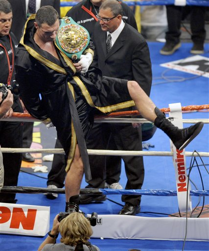 WBC  heavyweight  champion   Vitali  Klitschko   leaves the  ring   having  successfully  defended  his  title  against  Chris  Arreola  .        picture appears  courtesy  of   ap/photo/  Jae C . Hong  ..................