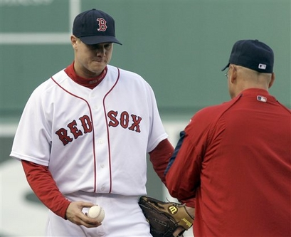 A  bewildered   Johnathan  Papelbon   ,  closer  for  the  Red  Sox  leaves  the   mound   in the   ninth   inning  of   game   3  in  the  ALDS  playoffs   against  the  Los  Angeles  Angels.   Also   seen  in   picture   is  the  Red  Sox  manager   Terry  Francona .               picture  appears   courtesy  of  ap/photo/  Elise  Amendola  ................